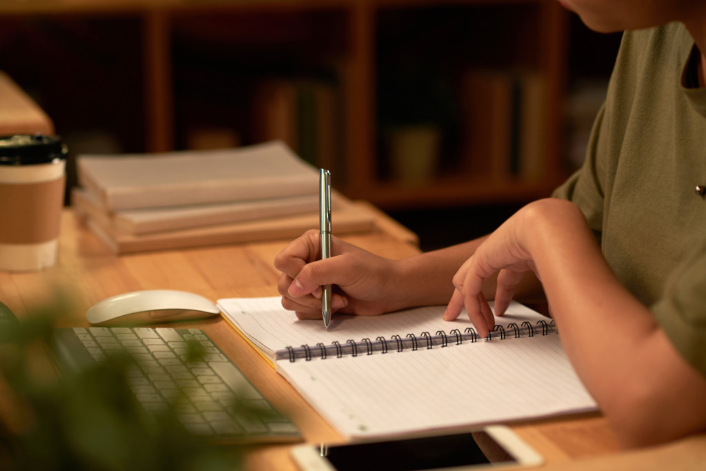 A student checking his writing skills after getting help from essay writing